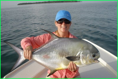 charter customer holding a permit fish